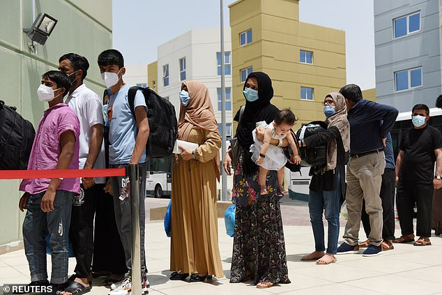 Evacuees from Afghanistan arrive at Emirates Humanitarian City in Abu Dhabi, UAE, on August 28. The memo from September 5 states Afghan girls told US officials there they had been raped by older men they were forced to marry to escape the Taliban