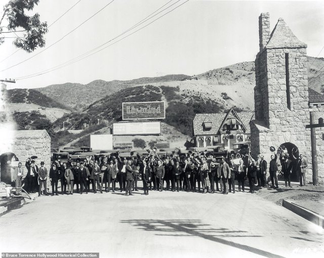 BEACHWOOD GATES: This photo dates back to 1924, showing the Beachwood Gates. 'Developer Albert Beach paved the way to the Hollywood Hills with a road named after himself – Beachwood Drive,' says Rosemary. The newly-formed Hollywoodland Tract Realty later built two stone towers on either side of Beachwood Drive, promising to create a gated community as part of a suburban housing development. Potential buyers would take a bus tour of the site to scope out the plots on offer