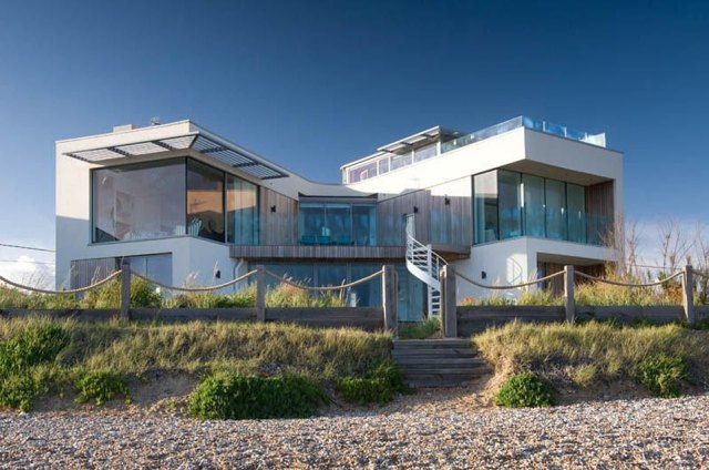 NO.12. SEA GEM CAMBER, CAMBER SANDS, EAST SUSSEX: This beach house has floor-to-ceiling windows that look out over the beach at Camber Sands and a private boardwalk that leads directly to the sand. It sleeps up to eight people and costs an average of £500 a night