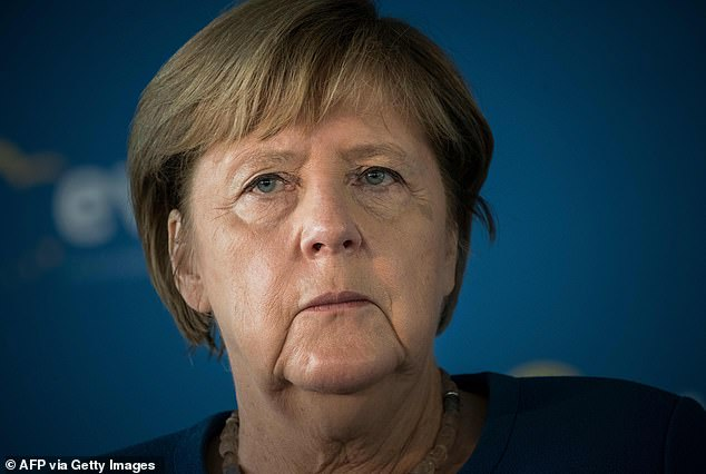 Angela Merkel (pictured on Thursday) has admitted that her party could finally lose power after she steps down later this month, with opinion polls showing its support has crumbled