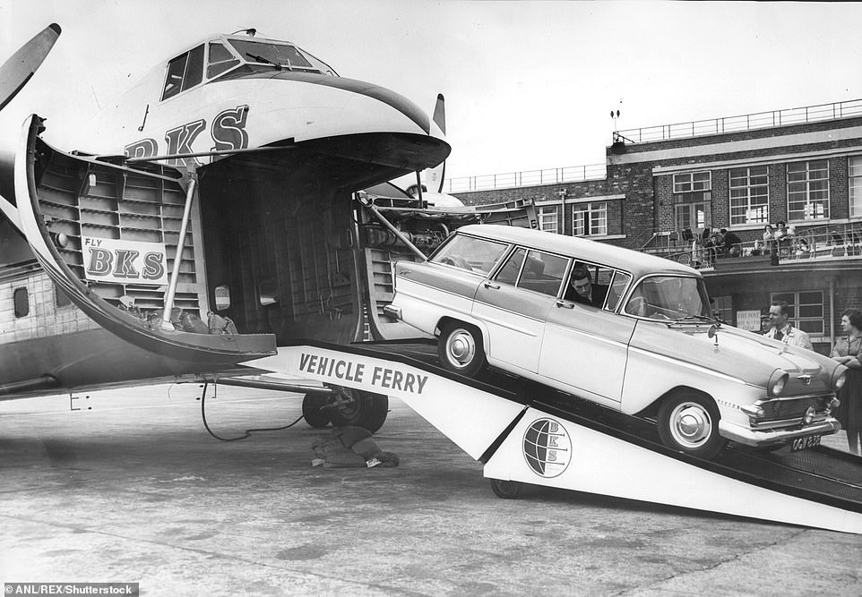 The plane was instantly recognisable thanks to its rounded nose doors ahead of a 'boxy' fuselage. Above: A car being loaded on to one of the planes for a flight to Dublin in 1960