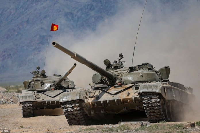 Kyrgyz servicemen on Soviet made T-80 main battle tanks take part in joint military drills with Belarus and Russia, in a move that has alarmed NATO