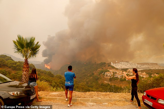 At least 1,000 people were forced to evacuate after a wildfire near Costa del Sol resort town Estepona was deemed 'out-of-control'