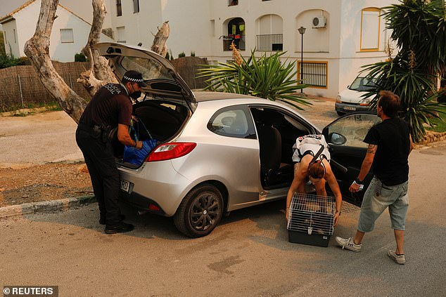 Many of the local residents and holidaymakers told to leave their homes spent the night in hotels or in their cars