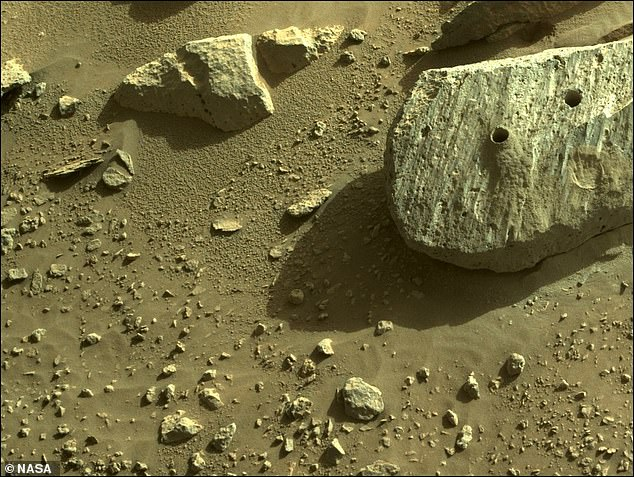 The latest sample was captured on Thursday by an SUV-sized rover, drilling into the same large boulder that produced the first sample last week - seen by two holes.