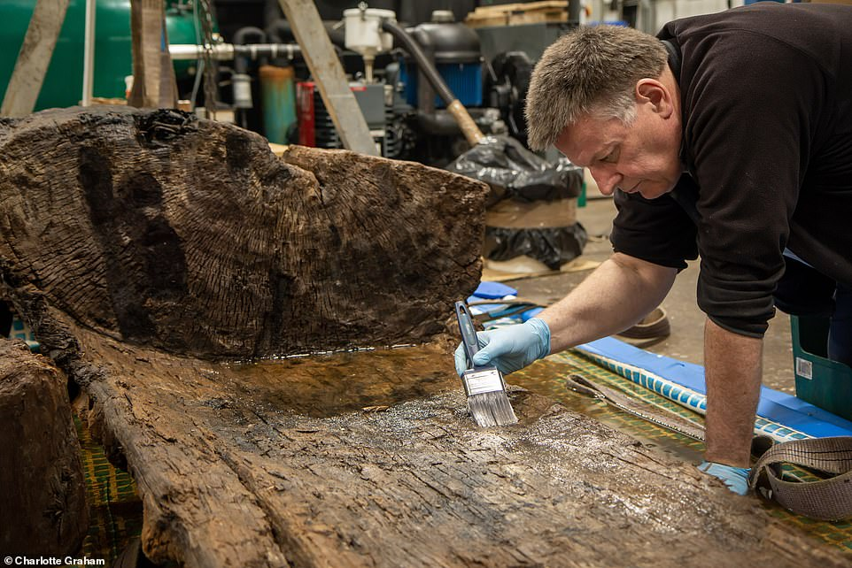 When preservation work (pictured) on the telephone-box-sized coffin and the axe are complete, the finds will be put on display in The Collection museum in Lincoln