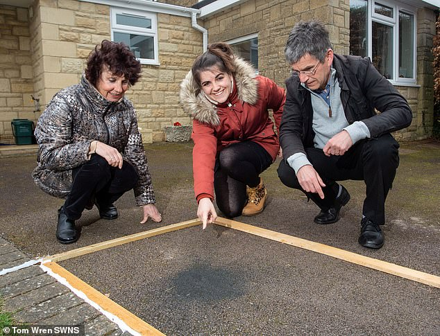 Hannah Wilcock, 25, and her parents Rob and Cathryn were astounded to learn that the 'lumps of coal' on their drive in Cotswolds were a 4.6-billion-year-old meteorite