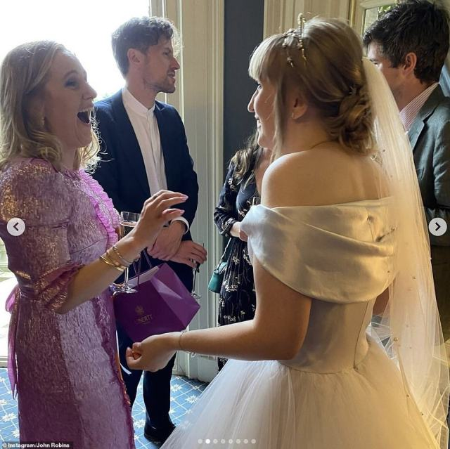All eyes on her: Bride Charlie greeted guests inside the wedding reception in one snap