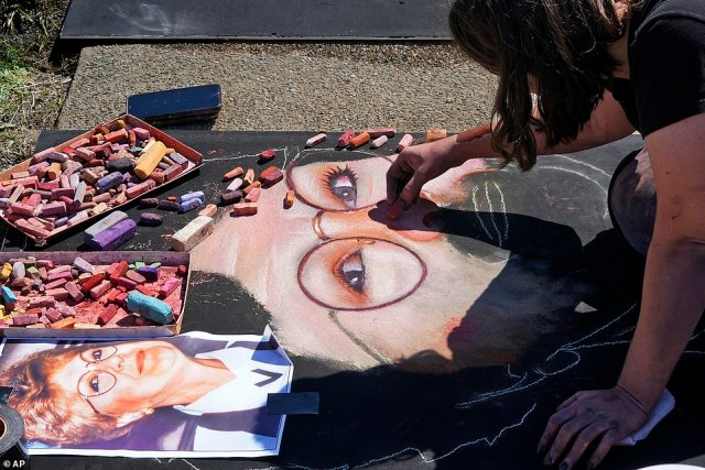 Naomi Haverland, of Orlando, Fla., (pictured) is one of several chalk artists who came together to pay tribute to the crew members and passengers of Flight 93 at the National Memorial in Somerset County. Heverland is pictured working on a portraitof flight attendant Lorraine G. Bay from East Windsor, N.J.