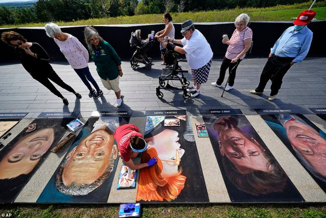 Chalk artist Erica LuBer (bottom center), from Allentown, Pa., works on a chalk portrait of Colleen Fraser, from Elizabeth, NJ., who was one of the 40 passengers and crew who perished on Flight 93