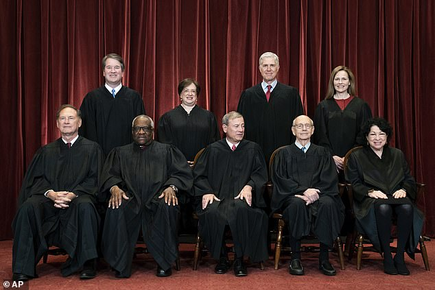 Breyer (seated, second from right) is the senior member of the court's three-judge liberal wing. They saw their numbers decrease from four to three, leading to Biden setting up a commission to examine reforming the Supreme Court
