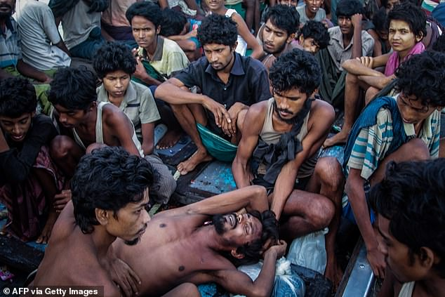 Rohingya migrants rest on a boat off the coast of Indonesia after Australian officials turned them back