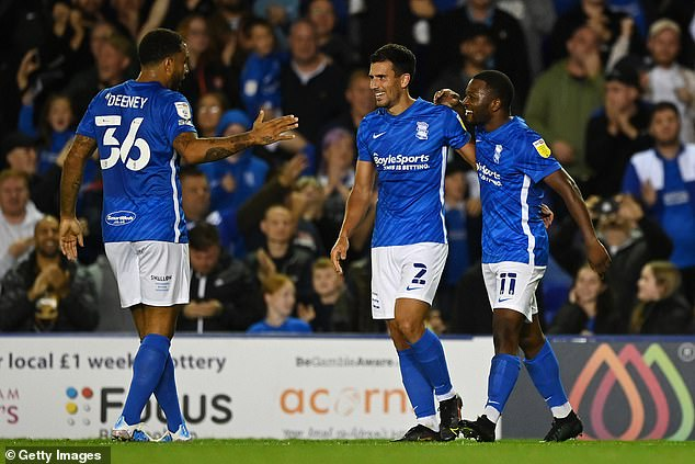 Jeremie Bela (right) secured the points late on after Scott Hogan's 50th-minute opener