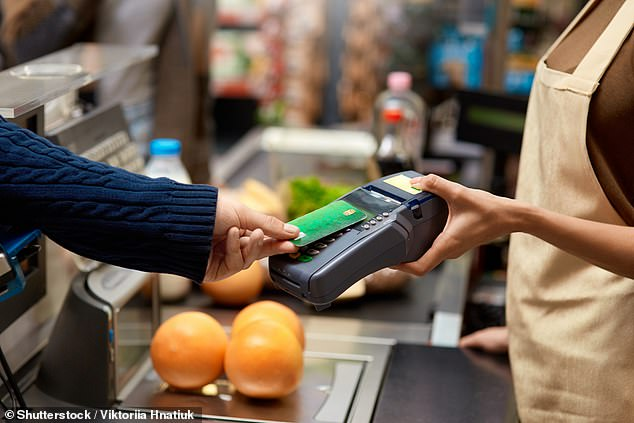 Many firms asked customers to use cards and mobile apps at the height of the crisis, saying that avoiding handling notes and coins would limit the spread of Covid (file image)