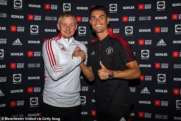 Cristiano Ronaldo is greeted by Ole Gunnar Solskjaer after returning to Manchester United