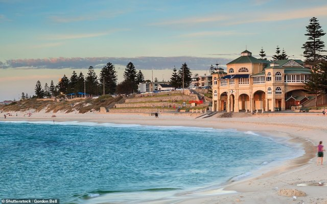 Pictured is Cottesloe, Perth's grandest city beach, where you can swim in the surf and sunbathe on the lawns