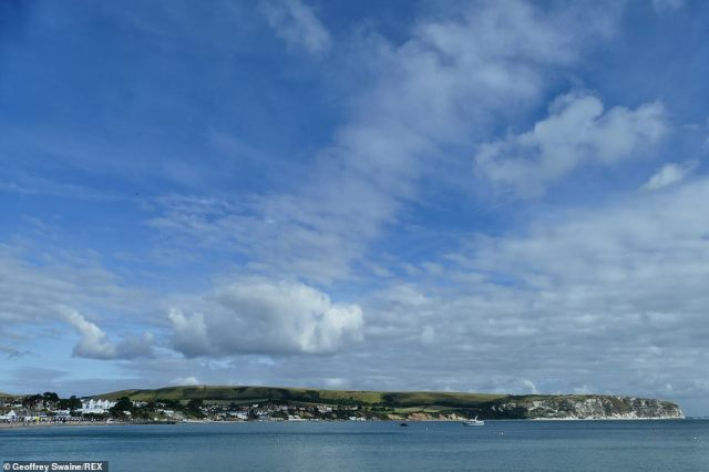 Despite the dry weather over most of the country, the Met Office has issued a flood alert in Porlock Weir, Somerset, today. Pictured: Blue skies in Ballard Down, Swanage, Dorset, today