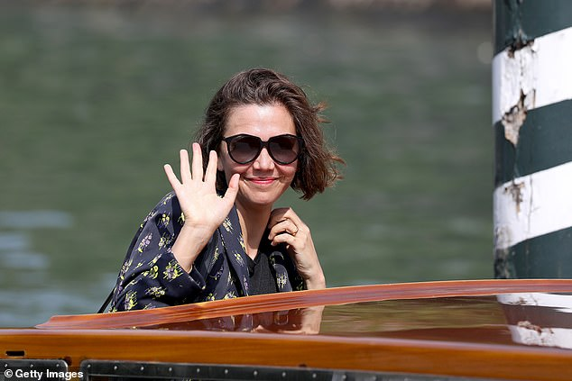 Cheerful: Marking the final day of the city's 78th International Film Festival, the 43-year-old actress shakes the audience's hand before exiting her taxi boat