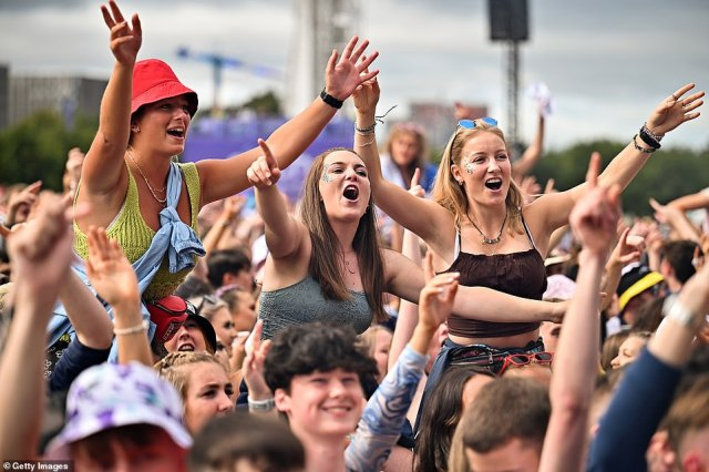 Revellers wearing glitter and bucket hats got lifted up on people's shoulders as they danced along to music, with Primal Scream and Picture This playing today and Liam Gallagher set to headline this evening