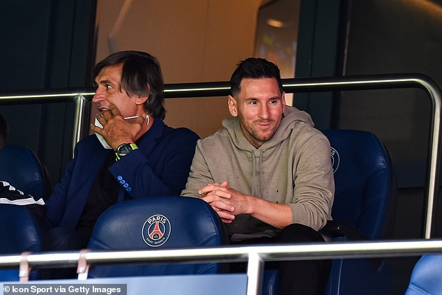 Lionel Messi (right) watched on after coming back from international duty too late