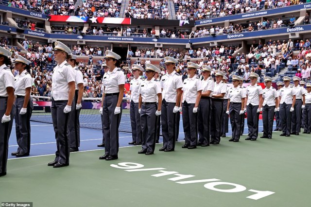 Female cadets stand beside a stencil of 9/11/01 in a ceremony to mark 20 years since the terror attacks in New York City ahead of the match
