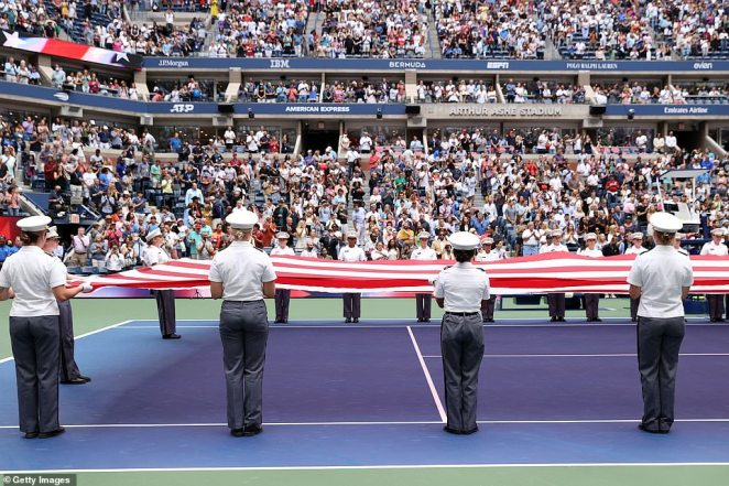 Members of the Military take part in the opening ceremony before the Women's Singles final match between Emma Raducanu of Great Britain and Leylah Annie Fernandez of Canada