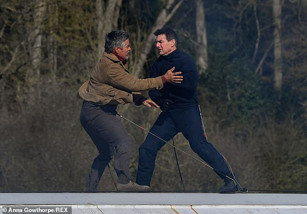 Tom Cruise and Esai Morales wear safety wires during filming for Mission: Impossible 7 in North Yorkshire