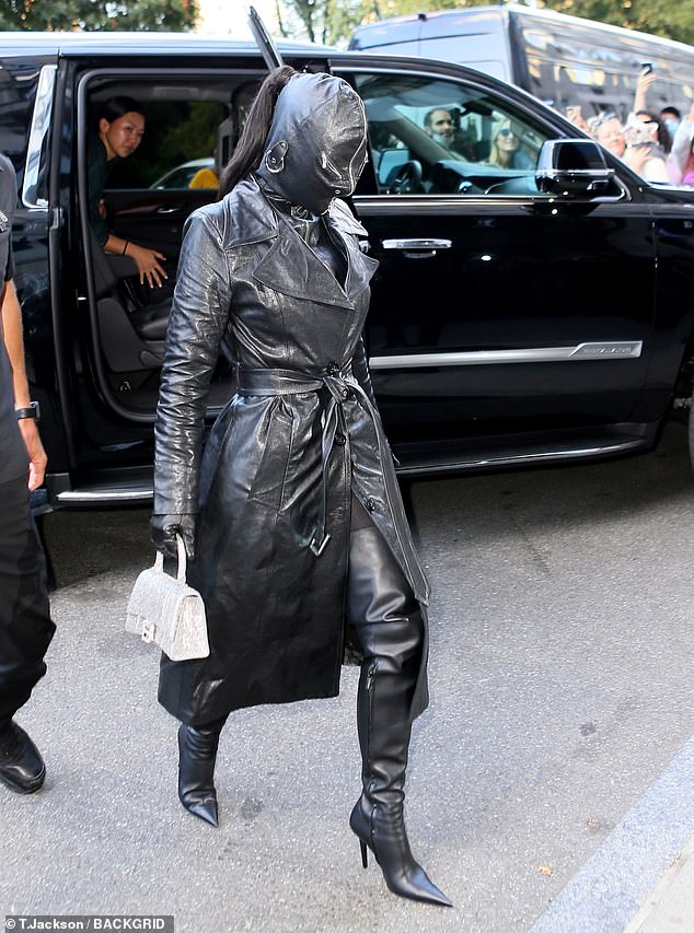 Leather weather: Her face was completely shielded by the leather face mask which had a zipper up the front and two where the eyes would be, with only her long ponytail sticking out of the back