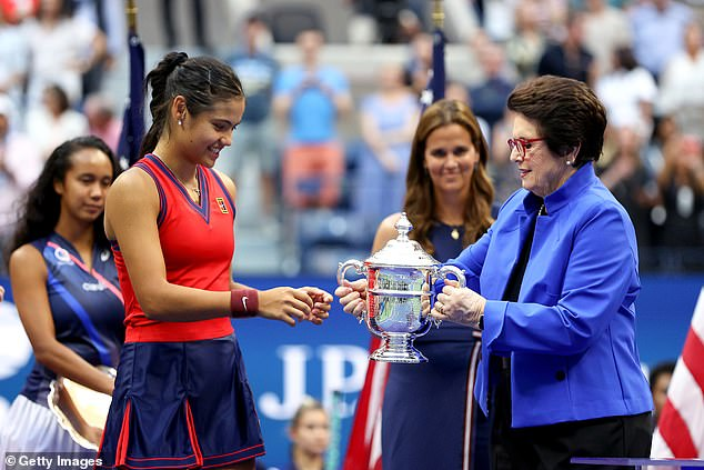 The 18-year-old Brit is presented with the trophy by tennis legend Billie Jean King
