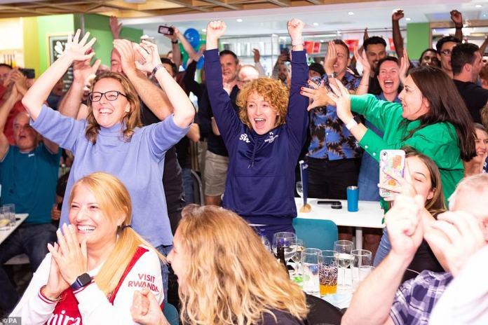 British Grand Slam winner Raducanu - The crowd erupts in jubilation at Raducanu's old tennis club in Beckenham. Suzanne Williams (centre) her former coach raises her arms into the air