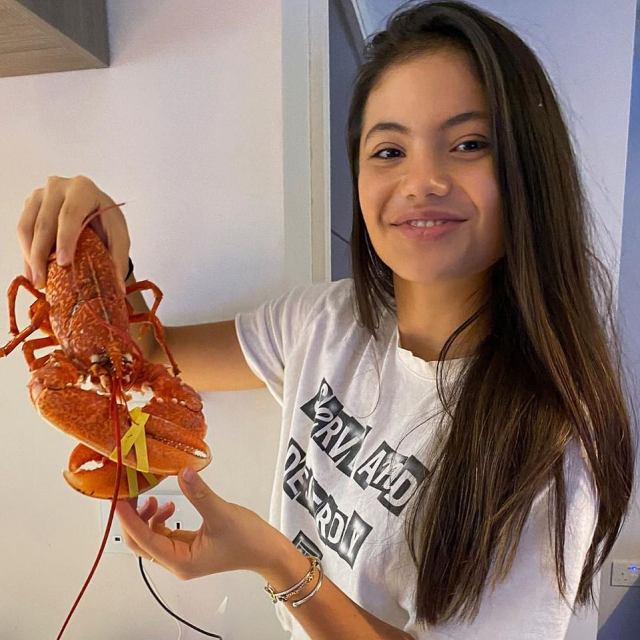 A STRONG CLAW-HAND: Young Emma looks set for a tasty lobster dinner