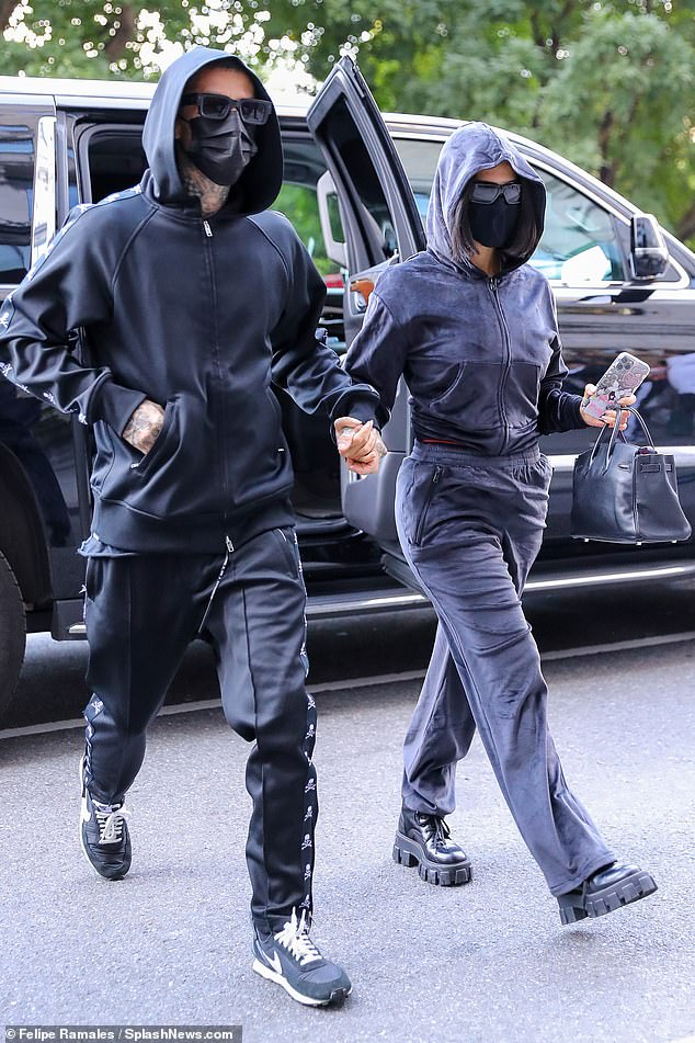 Shaking off scandal: The duo were seen arriving hand in hand to the hotel amid ex Scott Disick's swipe at their PDA by way of a DM on August 30