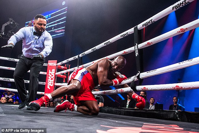 Evander Holyfield's first fight in 10 years was brutally ended on Saturday by Vitor Belfort