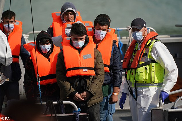 A group of suspected migrants arrive at Dover, Kent aboard a Border Force patrol boat
