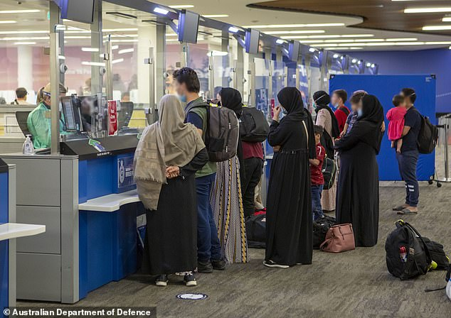 About 122,000 people have been evacuated from Afghanistan since the Taliban retook the capital of Kabul in August (pictured, Australian evacuees are seen returning home from Kabul)