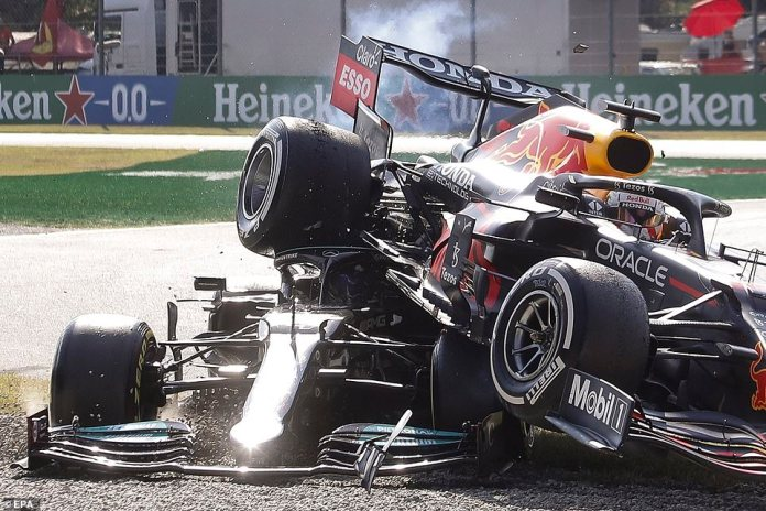 The Red Bull was left nose-first in the gravel trap with the Mercedes wedged underneath after the sensational crash