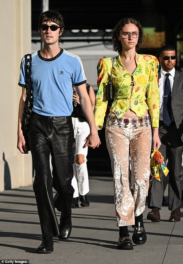 Emhoff, 22, confirmed her relationship with GQ editor Sam Hine, 27, in August. Above, the pair is pictured outside the Collina Strada show on Thursday in Brooklyn