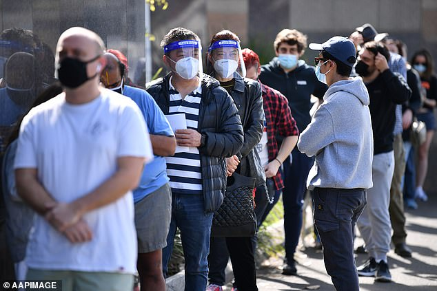 By Friday, 76.4 per cent of the NSW adult population had at least one vaccine jab, with 43.6 per cent double-dosed (pictured, a queue for vaccines in Sydney's inner west)