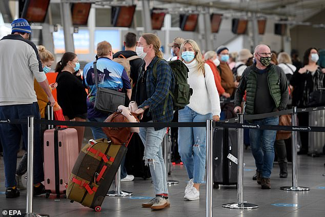 NSW residents could be among the first Australians to pack their bags for a long overdue overseas holiday (pictured, travellers at Sydney domestic airport in June)