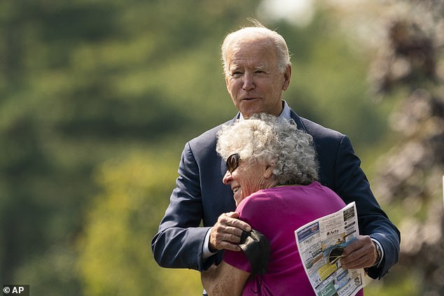 Biden's announcement will come before the United Nations General Assembly meetings, which kick off on Tuesday. Here Biden hugs a woman after talking outside St. Joseph on the Brandywine Church in Wilmington, Delaware on Sunday