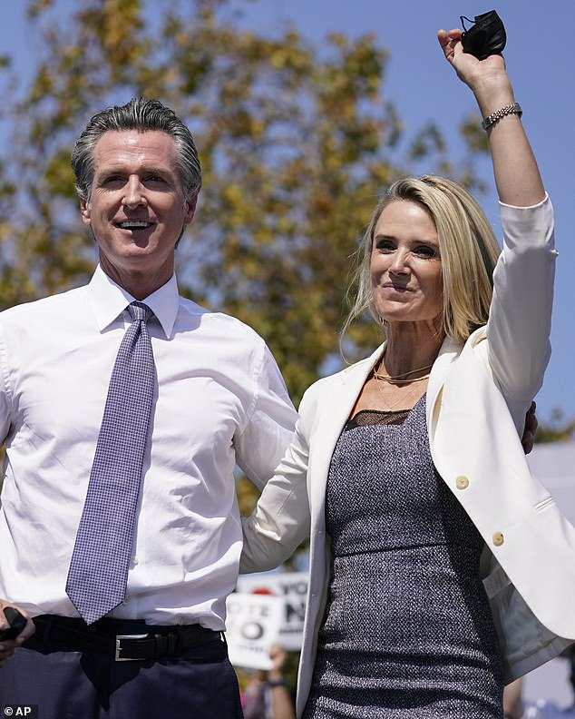 According to McGowan, California First Lady Jennifer Siebel Newsom (seen right with Governor Gavin Newsom in San Leandro, California on Wednesday), called her on behalf of David Boies, the attorney representing disgraced Hollywood mogul Harvey Weinstein, in 2017