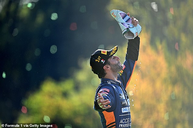 The Aussie, who is known for his exuberant celebrations, gestured to the crowd in the post-race presentation before pouring a beer into his boot and performing the shoey