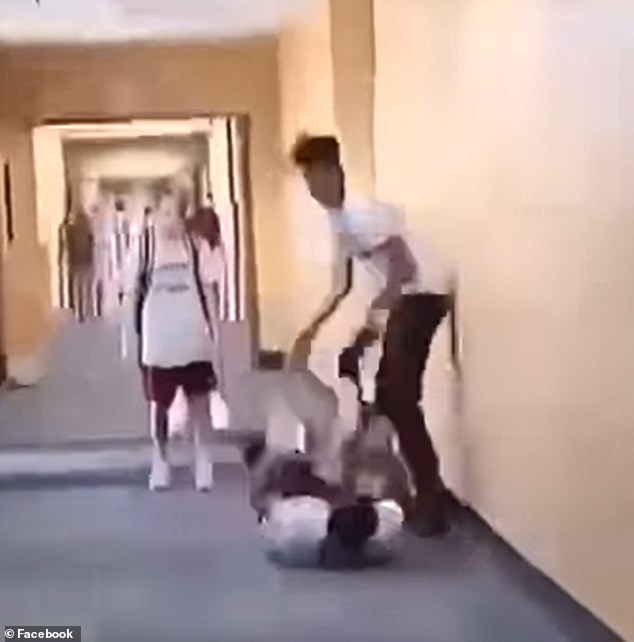 Ruffin's husband, Miguel Aviila, posted a video online which he claims shows the other boy punching his son in the hallway while he lies on the ground.