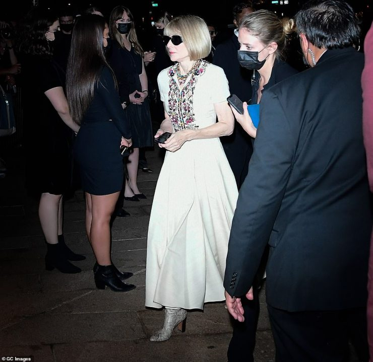Big wig:Vogue queen-pin Anna Wintour arrived in a hurry, donning an elegant cream dress with floral embroidery framing a collared neckline