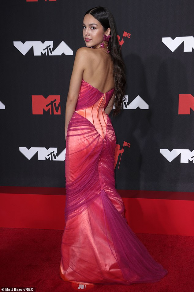 Shining star: Olivia Rodrigoooked pretty in pink as she strutted her stuff down the red carpet of the 2021 MTV Music Video Awards in Brooklyn, New York on Sunday night