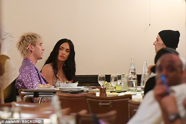 Cooling down:They met up with their pals Kourtney and Travis for a relaxed late night dinner after the commotion of the evening