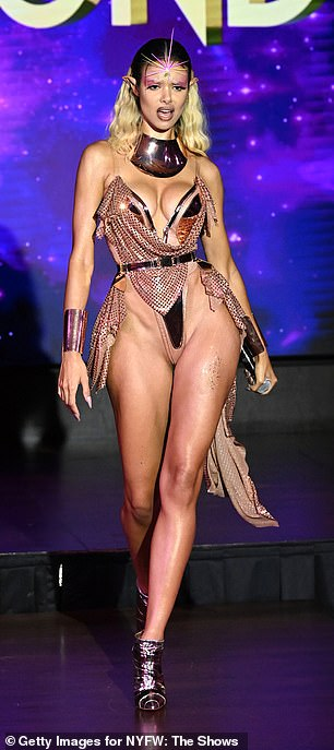 Showing skin: Bodine wore another warrior inspired look which included a barely-there leotard
