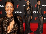 Ciara is lovely in sheer lacy number with cutout at chest as she turns heads on MTV VMAs red carpet