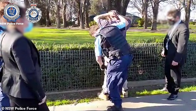 He was charged withbreaching the firearms act after police allegedly found a 3D blueprint to manufacture a firearm (pictured, the Orange resident being arrested)