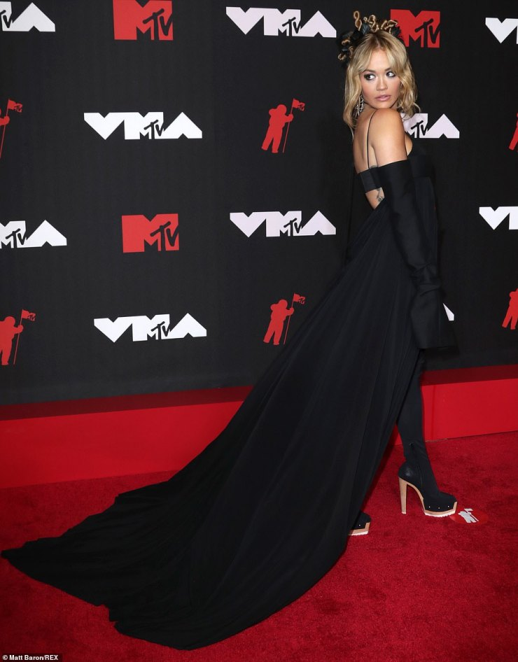 Drama: Rita looked stunning in an ab-flashing Vera Wang bodysuit with a cape and gloves